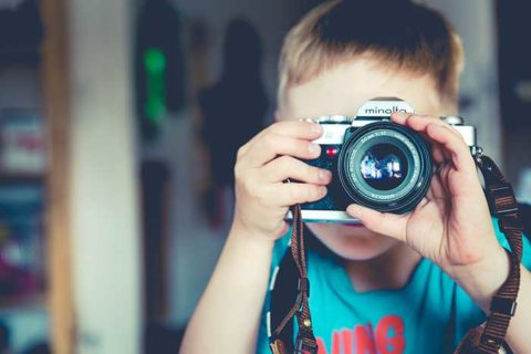 Little Boy Taking Picture with Camera