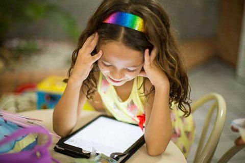 little girl using tablet